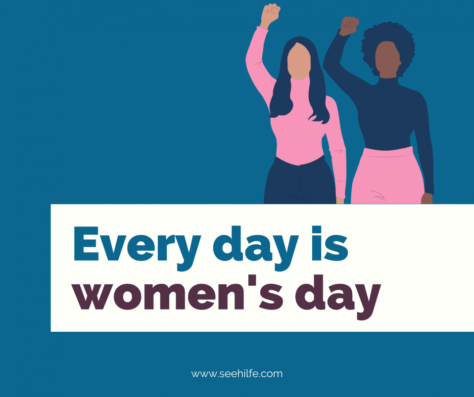 Image of two women raising their arms